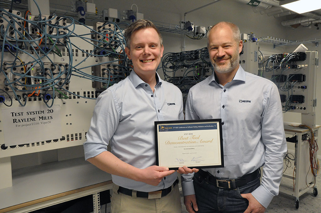 Westermo's Per Erik Strandberg (left) and Johan Beijnoff with their award for 'Best Demo' at the ICST 2018 conference.